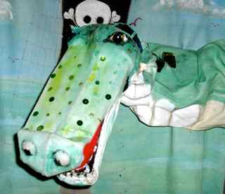 Big green crocodile puppet for birthday parties