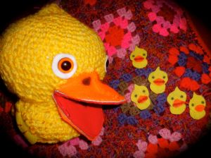 Yellow crochet duck puppet